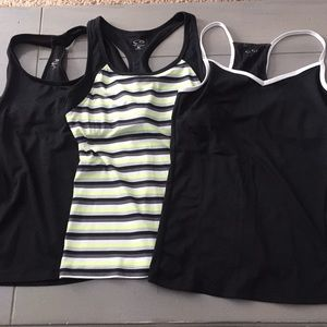 3 shirts for the price of one! Workout tanks!